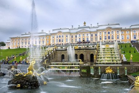 ST. PETERSBURG, RUSSIA - August 14: gold plated sculptures by fountains Grand cascade in Peterhof, Saint Petersburg, Russia on August 14, 2014