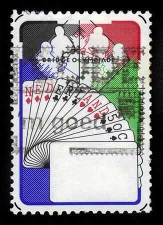 olympiad: NETHERLANDS - CIRCA 1980 A stamp printed in Netherlands shows Bridge Players, Netherlands Hand, 6th Bridge Olympiad, Valkenburg, circa 1980