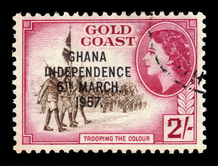 gold standard: GHANA - CIRCA 1957: A stamp printed in Ghana shows standard bearers and queen Elizabeth II, stamp of Gold Coast overprinted in black, Ghana Independence, circa 1957