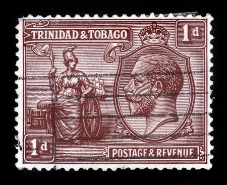 britannia: TRINIDAD AND TOBAGO - CIRCA 1922: A stamp printed in Trinidad and Tobago shows Britannia and portrait of King George V, circa 1922