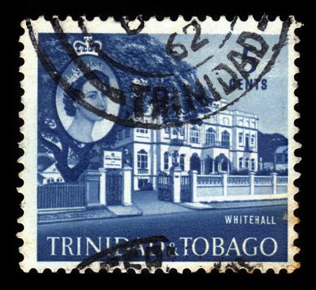 TRINIDAD AND TOBAGO - CIRCA 1960: A stamp printed in Trinidad and Tobago shows Whitehall, official office of the Prime Minister and portrait of Queen Elizabeth II, circa 1960 Editorial