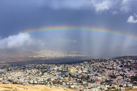 first miracle: rainbow over the arab village Cana of Galilee ( Kafr Kanna ) in Israel , place where Christ showed first miracle Stock Photo