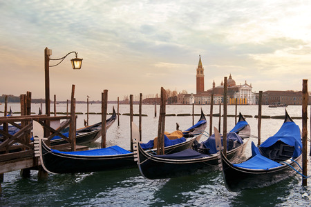 early morning in Venice, empty venetian gondolas moored Stock Photo
