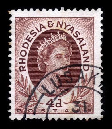caf: RHODESIA AND NYASALAND - CIRCA 1954: A stamp printed in Federation of Rhodesia and Nyasaland, also known as the Central African Federation (CAF) shows Queen Elizabeth II, circa 1954