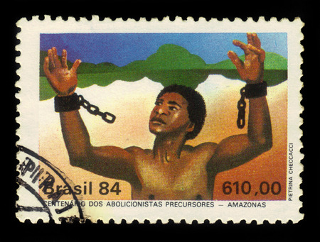slavery: Brazil - CIRCA 1984: a stamp printed in Brazil shows slave tearing the chain, abolition of slavery in countries of Amazon, circa 1984