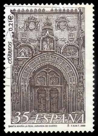 SPAIN - CIRCA 2000: A stamp printed in Spain shows principal facade of the Church of Santa Maria la Real. Aranda de Duero (Burgos), circa 2000