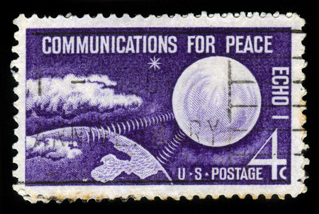 united states postal service: UNITED STATES - CIRCA 1960: A stamp printed in the United States, shows radio waves connecting Echo I and Earth, with inscription communication for Peace, circa 1960