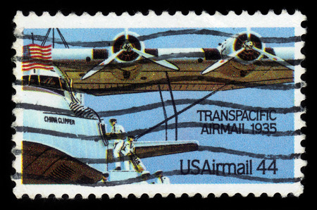united states postal service: UNITED STATES - CIRCA 1985: A stamp printed in the United States, shows aircraft Martin M-130 China Clipper, Transpacific Airmail 1935, circa 1985 Editorial