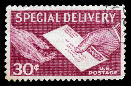 united states postal service: UNITED STATES OF AMERICA - 1957: A stamp printed in the USA shows hands and letter, postal service for special delivery of letters, 1957