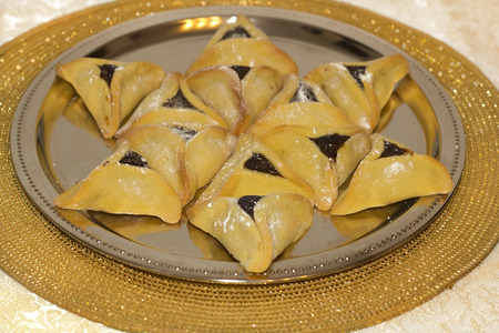 book of esther: Star of David made from Hamantaschen cookies for Jewish festival of Purim Stock Photo