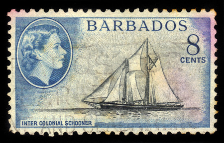 schooner: BARBADOS - CIRCA 1954: A stamp printed in Barbados shows inter colonial schooner and portrait of Queen Elizabeth II, circa 1954