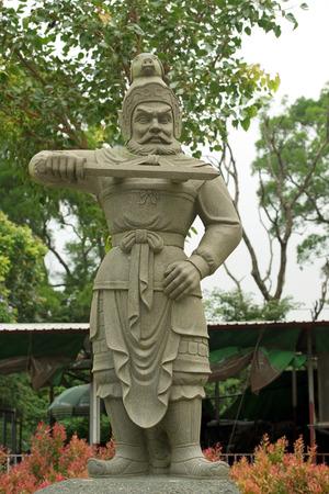 stone statue of ancient chinese warrior, Po Lin Monastery, Hong Kong photo
