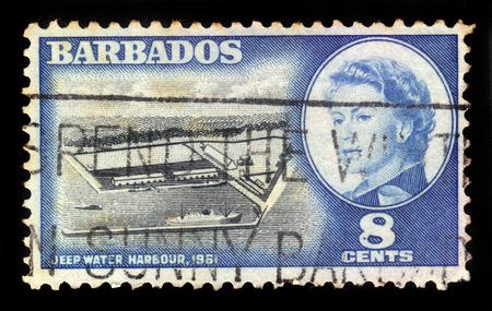 queen elizabeth ii: BARBADOS - CIRCA 1961: a stamp printed in Barbados shows Deep Water Harbour ( Port of Bridgetown ) and portrait of Queen Elizabeth II, circa 1961