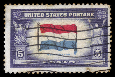 UNITED STATES OF AMERICA - CIRCA 1943: a stamp printed in USA, shows Flag of Netherlands, overrun countries series, circa 1943