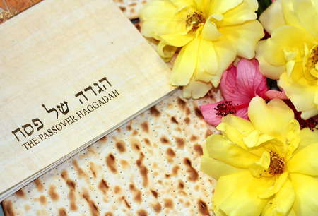 spring holiday of Passover and its attributes, with matzo and Haggadah in Hebrew - Happy Passover