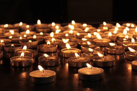 church: burning memorial candles on dark background