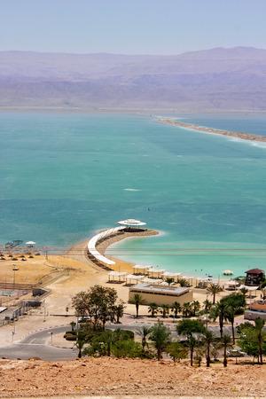 Ein Bokek beach on the shores of the Dead Sea, unique salt lake, Israel photo