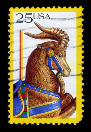 he goat: USA - CIRCA 1988: a stamp printed in the USA shows carousel animals: goat, american folk art series, circa 1988