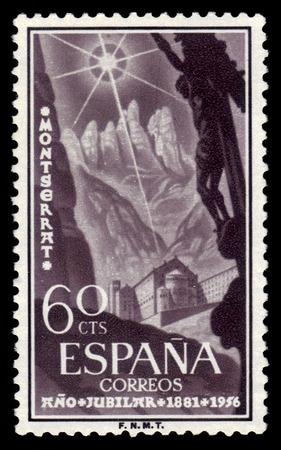 Spain - CIRCA 1956: A stamp printed in Spain shows benedictine abbey at Montserrat, Santa Maria de Montserrat, near Barcelona, Catalonia, Spain, circa 1956 Editorial