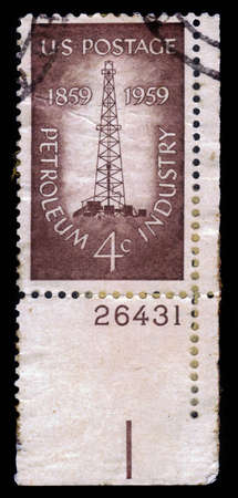 oil derrick: USA - CIRCA 1959: a stamp printed in the USA, shows an oil derrick, centenary of the first oil derrick at Titusville, Pennsylvania, petroleum industry issue, circa 1959 Editorial