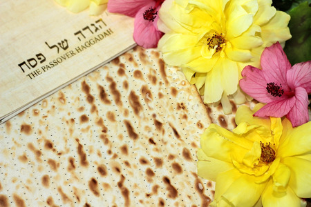 attributes: spring holiday of Passover and its attributes, with matzo and Haggadah in Hebrew - Happy Passover