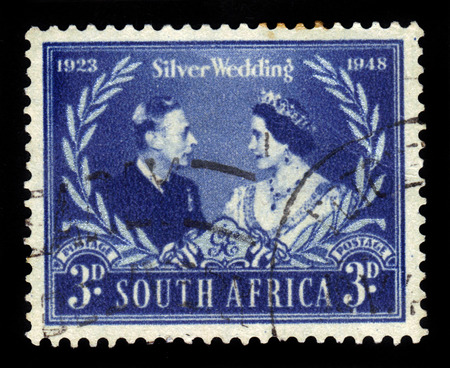 South Africa - CIRCA 1948: A stamp printed in South Africa shows King George VI and Queen Elizabeth, issued for the Royal Silver Wedding, circa 1948