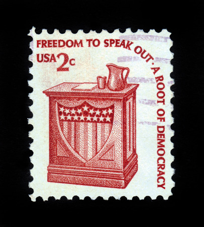 speak out: USA - CIRCA 1975: A stamp printed in United States of America shows Speaker stand and the inscription freedom to speak out. a root of democracy circa 1975