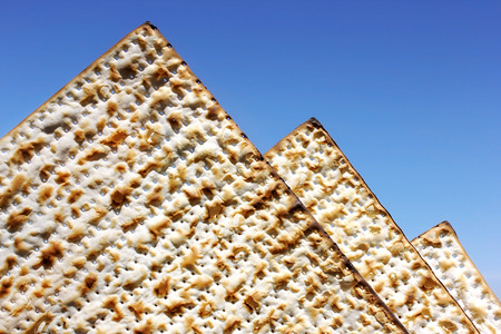 egyptian pyramids: jewish holiday of Passover, matzo as the egyptian pyramids on the background of bright blue sky