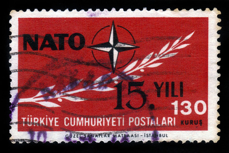 nato: TURKEY - CIRCA 1964: a stamp printed in Turkey shows emblem of NATO (  North Atlantic Treaty Organization ), 15 years NATO, circa 1964 Editorial