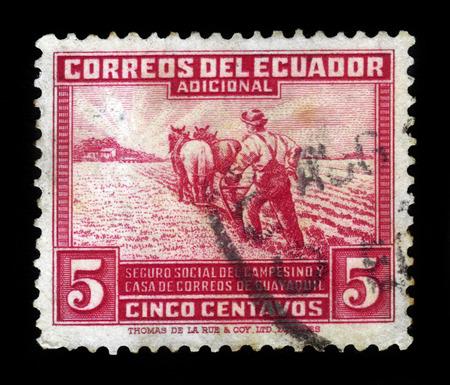 obligatory: ECUADOR - CIRCA 1940: a stamp printed in Ecuador shows farmer ploughing, issue obligatory tax, social insurance fund for rural workers, circa 1940