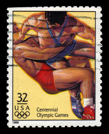 centennial: USA - CIRCA 1996: A stamp printed in the United States shows wrestling dedicated to centennial olympic games, circa 1996.