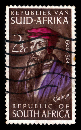 reformation: SOUTH AFRICA - CIRCA 1964: A stamp printed in South Africa shows John Calvin, french theologian and pastor during the protestant reformation, circa 1964 Editorial