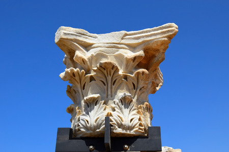 remains of ancient corinthian columns on a background of the blue sky, Caesarea Maritima national park, Israel