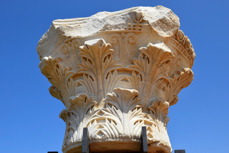 caesarea: remains of ancient corinthian columns on a background of the blue sky, Caesarea Maritima national park, Israel Editorial