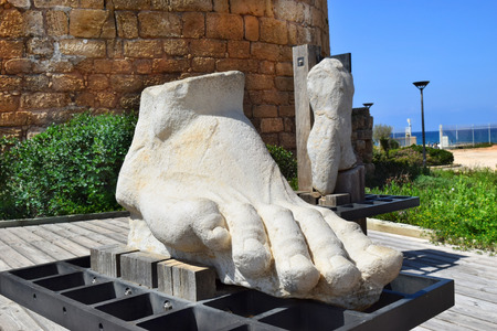 Caesarea Israel  march 19 : giant human foot carved from a stone in Caesarea Maritima national park march 19 2015 Caesarea Israel was built by Herod the Great at mediterranean coast of Israel Editorial