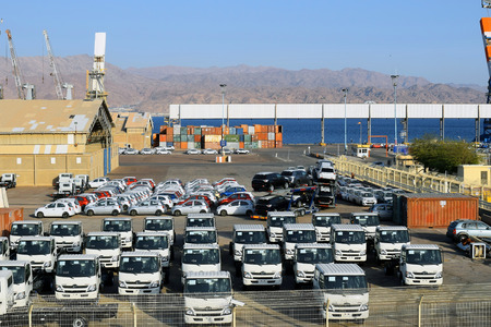 importation: EILAT ISRAEL  MARCH 12 2015 : cargo port and new cars for sale in Israel  Eilat Israel on March 12 2015 Eilat port is located on the coast of the Red Sea