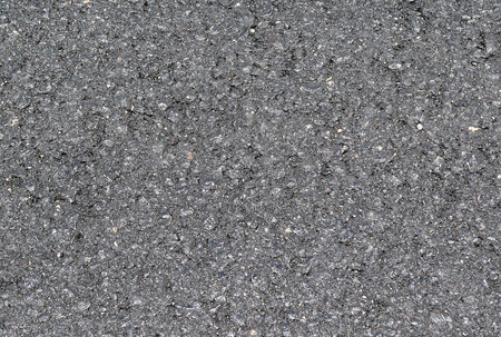 inclusions: surface of the asphalt with very small inclusions as background