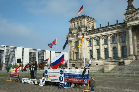 BERLIN GERMANY OCTOBER 13:members of the antifascist organization protested at the entrance to the Reichstag building in Berlin Germany on october 13 2014