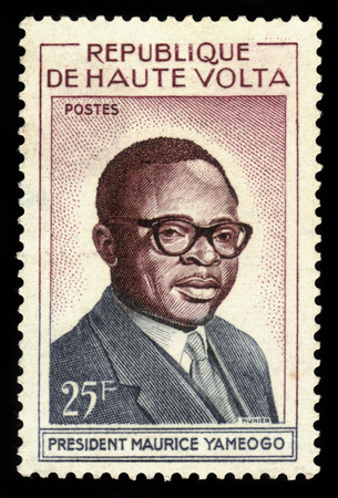 Upper Volta   CIRCA 1960: a stamp printed in the Upper Volta shows president Maurice Yameogo circa 1960