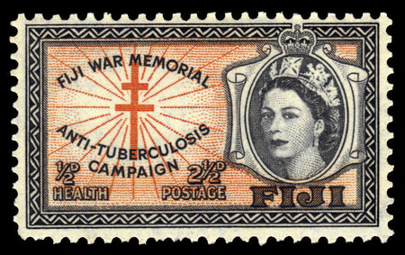 queen elizabeth: Fiji  CIRCA 1954: a stamp printed in Fiji showing cross and portrait of the Queen Elizabeth II  circa 1954.