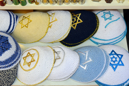 religious clothing: knitted jewish religious caps yarmulke on the market in Jerusalem Israel