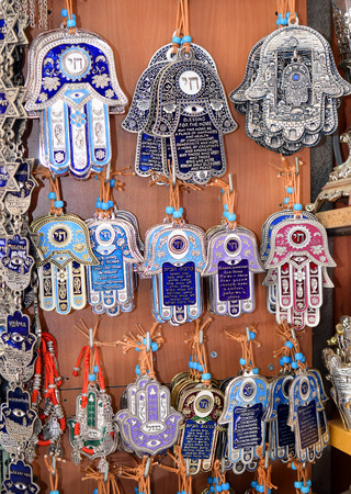 evil eye: hamsa - traditional palm-shaped amulet popular the Middle East and North Africa, used as a sign of protection against the evil eye in the Jewish tradition on a market in Jerusalem, Israel