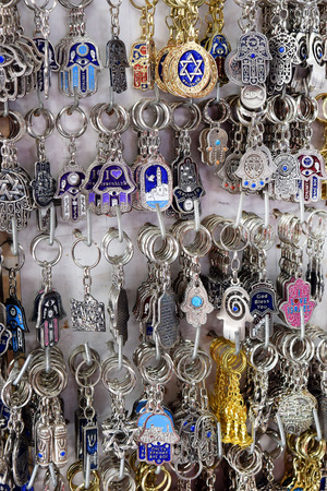 evil eye: keychains, hamsa - traditional palm-shaped amulet popular the Middle East and North Africa, used as a sign of protection against the evil eye in the Jewish tradition on a market in Jerusalem, Israel