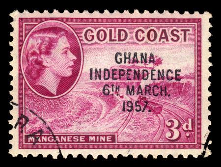queen elizabeth ii: GHANA - CIRCA 1957: A stamp printed in Ghana shows Queen Elizabeth II and manganese mine, stamp of Gold Coast overprinted in black, Ghana Independence, circa 1957