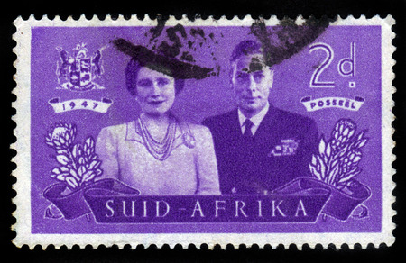 vi: SOUTH AFRICA - CIRCA 1947: a stamp printed in South Africa shows King George VI and Queen Elizabeth, circa 1947