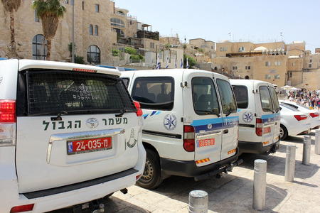 troops: JERUSALEM, ISRAEL - June 03, 2015: police cars and cars of border troops of Israel at the Wailing Wall in Jerusalem, on June 03, 2015, Israel