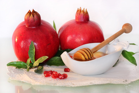 jewish background: symbols of holiday of Rosh Hashanah, traditional jewish food, honey and pomegranate Stock Photo