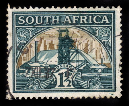 gold mine: SOUTH AFRICA - CIRCA 1936: a stamp printed in South Africa shows gold mine, circa 1936