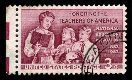 honoring: UNITED STATES OF AMERICA - CIRCA 1957: A stamp printed in the USA shows teacher with pupils, honoring the school teachers of America, circa 1957 Editorial