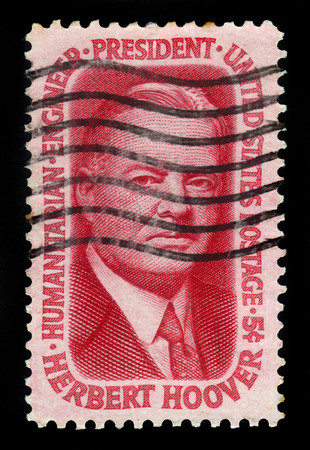 31st: UNITED STATES OF AMERICA - CIRCA 1965: A stamp printed in the USA shows Herbert Clark Hoover was the 31st President of the United States, circa 1965
